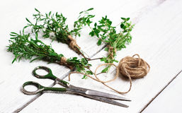 Mix of herbs on a wooden table, savory, thyme Stock Image