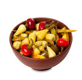 Mix of hot turkish marinated peppers in ceramic bowl Stock Images