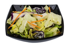 Mix of iceberg lettuce, red cabbage and carrots in bowl. Mix of iceberg lettuce, red cabbage and carrots in black bowl Royalty Free Stock Image