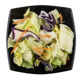 Mix of iceberg lettuce, red cabbage and carrots in bowl. Mix of iceberg lettuce, red cabbage and carrots in black bowl. Top view Royalty Free Stock Photos