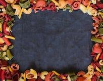 Mix of Italian pasta on dark textile background Royalty Free Stock Image