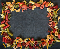 Mix of Italian pasta on dark textile background Royalty Free Stock Images
