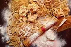 Mix of italian pasta with white flour Stock Photo