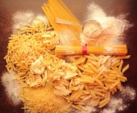Mix of italian pasta with white flour Royalty Free Stock Photos