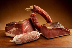 Mix italian salami. Parma ham over ancient wood table stock photography