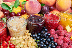 Mix of jams and fruits Royalty Free Stock Photos