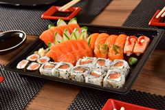 Japanese food to go. Mix of Japanese food on to go package royalty free stock image