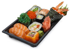 Mix japanese rolls and sushi assorti. On black background Royalty Free Stock Photo