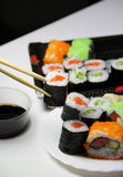 Mix of Japanese sushi and rolls Royalty Free Stock Photos