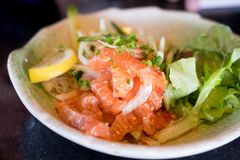 Japan salmon spicy salad with herbs Stock Photos