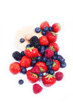 Mix of juicy berries. Juicy, ripe strawberries, blueberries, raspberries and blackberries on a white background Stock Photography