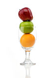 Mix of juicy fruits in wine glass stock images
