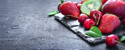 Mix of Juicy summer fruits and berries. Strawberry, cherry, kiwi stock photo