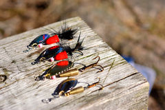 Mix lures spinners on wood Stock Photo