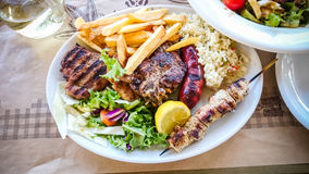Mix meat plate with french fries Stock Image