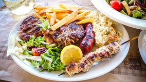 Mix meat plate with french fries Stock Images