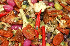Mix of Mediterranean fruits and pickles with onions and peppers Royalty Free Stock Photo