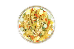 Mix of noodles and vegetables in a glass cup. On a white background Stock Image