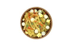 Mix of noodles and vegetables in a wooden bowl. On a white background Royalty Free Stock Photography