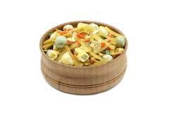 Mix of noodles and vegetables in a wooden dish. On a white background Stock Images