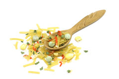 Mix of noodles with vegetables in a wooden spoon. On a white background Royalty Free Stock Image
