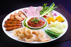 Mix Northern Thai food - Sai Aua (Northern Thai Spicy Sausage), Naem (Sour pork), Cab-Moo (pork snack), Moo-Yor (preserved pork sa Royalty Free Stock Photos
