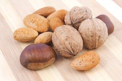 Mix nuts. Assortment of tasty nuts on wooden background Stock Image