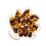 Mix of nuts and berries: raisins, hazelnut, cashews, almonds, cranberries, dried dates and apricots. Plate of dried. Fruits on white, isolated on white royalty free stock images