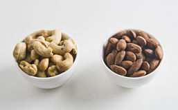 Mix Nuts. Nuts on botter on white backgrund Royalty Free Stock Images
