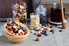 Mix nuts in a bowl on the table and jar Stock Photos