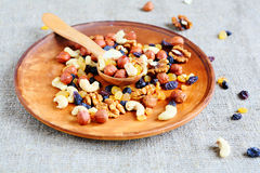Mix nuts on ceramic plate Royalty Free Stock Photo