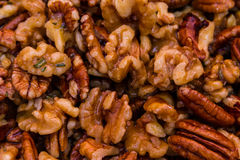 Mix nuts covered in butter garlic and rosemary mixture before ro Royalty Free Stock Images
