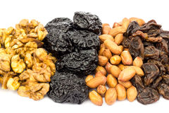Mix of nuts and dried fruits isolated on white background Royalty Free Stock Photography