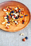 Mix nuts and dried fruits on a plate Royalty Free Stock Images