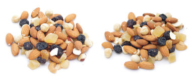 Mix nuts, dry fruits and grapes. On a white background Royalty Free Stock Photos