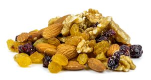Mix nuts and dry fruits on a white background Royalty Free Stock Images