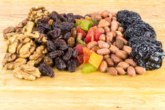Mix of nuts and dry fruits on wooden background Stock Images