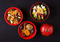 Mix nuts and fruits. Various mix nuts, dried fruits and fresh fruits on the black background royalty free stock photography