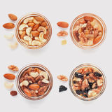 Mix of nuts in glass pots with honey, dried fruits royalty free stock image