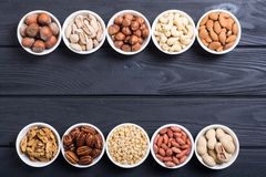 Mix of nuts. Pistachios, almonds , walnuts , pine nut , hazelnuts and cashew . Snack in bowl backgrond royalty free stock photography