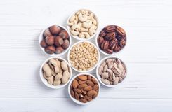 Mix of nuts. Pistachios, almonds , walnuts , pine nut , hazelnuts and cashew . Snack in bowl backgrond royalty free stock image