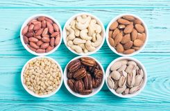 Mix of nuts. Pistachios, almonds , walnuts , pine nut , hazelnuts and cashew . Snack in bowl backgrond stock image