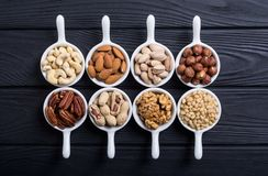 Mix of nuts. Pistachios, almonds , walnuts , pine nut , hazelnuts and cashew . Snack in bowl backgrond stock images