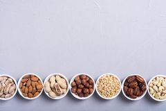 Mix of nuts. Pistachios, almonds , walnuts , pine nut , hazelnuts and cashew . Snack in bowl backgrond stock photos