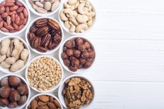 Mix of nuts. Pistachios, almonds , walnuts , pine nut , hazelnuts and cashew . Snack in bowl backgrond royalty free stock photos