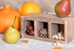 Mix of nuts: pistachio, almonds, hazelnut, peanuts in vintage wooden box on rustic wooden background. Top view. Raw healthy food. Mix of nuts: pistachio stock image