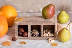 Mix of nuts: pistachio, almonds, hazelnut, peanuts in vintage wooden box on rustic wooden background. Top view. Raw healthy food. Mix of nuts: pistachio royalty free stock image