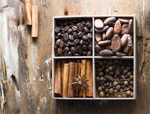 Mix of nuts: pistachio, almonds, hazelnut, peanuts in vintage wooden box on rustic wooden background. Top view. Raw healthy food. stock image