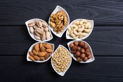 Mix of nuts. Pistachios, almonds , walnuts , pine nut , hazelnuts and cashew . Snack in bowl backgrond stock photography