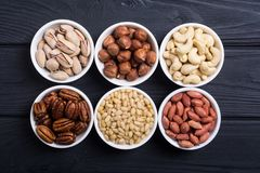 Mix of nuts. Pistachios, almonds , walnuts , pine nut , hazelnuts and cashew . Snack in bowl backgrond royalty free stock photo